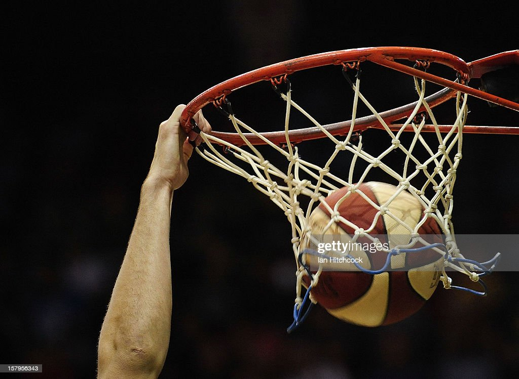 Russell Hinder makes a slam dunk at the warm up before the start of the round ten NBL match between the Townsville Crocodiles and the Melbourne Tigers at Townsville Entertainment Centre on December 8, 2012 in Townsville, Australia.