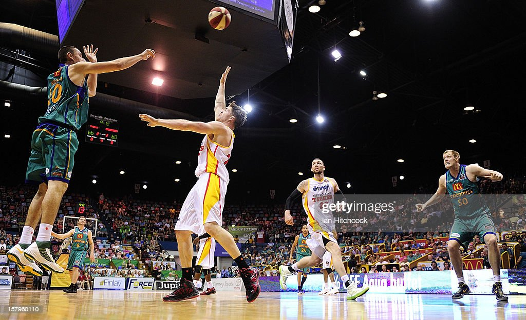 Russell Hinder of the Crocodiles attempts a jump shot during the round ten NBL match between the Townsville Crocodiles and the Melbourne Tigers at Townsville Entertainment Centre on December 8, 2012 in Townsville, Australia.