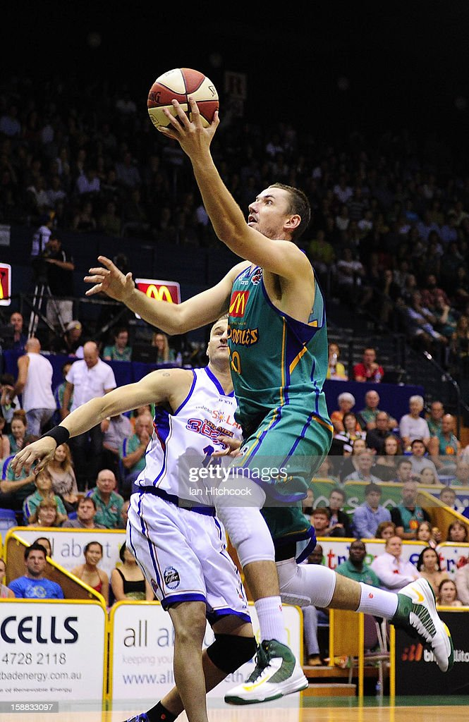 Russell Hinder of the Crocodiles goes for a layup during the round 12 NBL match between the Townsville Crocodiles and the Adelaide 36ers at Townsville Entertainment Centre on December 31, 2012 in Townsville, Australia.