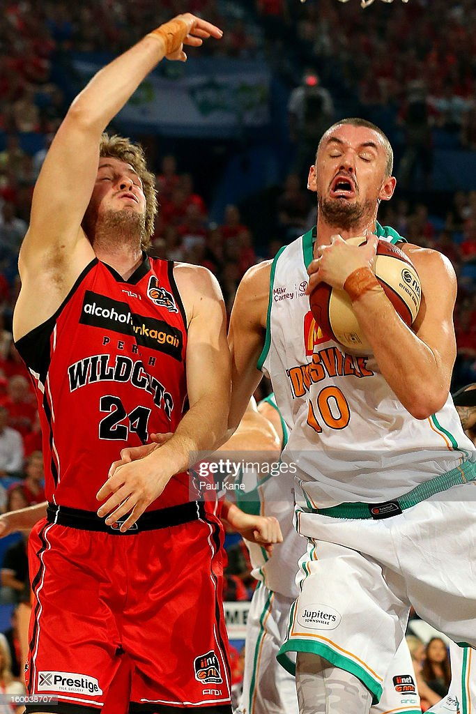 Russell Hinder of the Crocodiles rebounds against Jesse Wagstaff of the Wildcats during the round 16 NBL match between the Perth Wildcats and the Townsville Crocodiles at Perth Arena on January 25, 2013 in Perth, Australia.