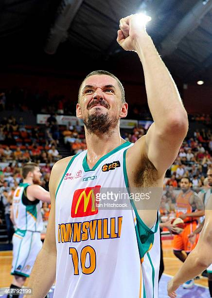 Russell Hinder of the Crocodiles salutes the crowd after winning the round 17 NBL match between the Cairns Taipans and the Townsville Crocodiles at...