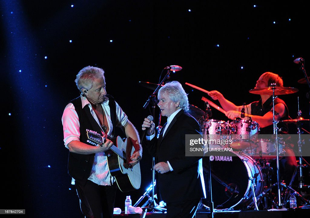 Russell Hitchcock (C) and Graham Russell (L) of Australian-British music duo Air Supply perform onstage during their 2013 World Tour in Kuta, Indonesia's resort island of Bali, on May 1, 2013.