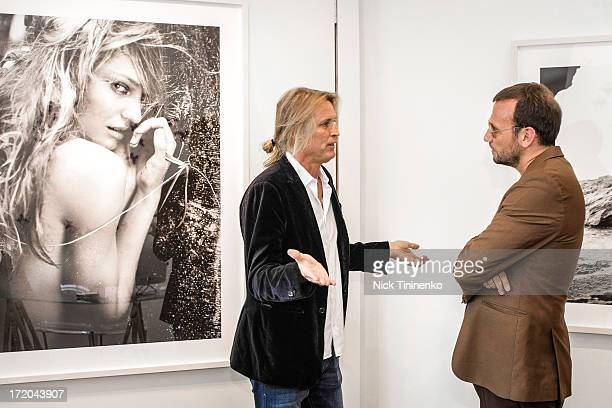 Russell James and Mauro Porcini talking at Adriana Lima Hosts Russell James Exhibition Opening at 212 Gallery on June 28 2013 in Aspen Colorado