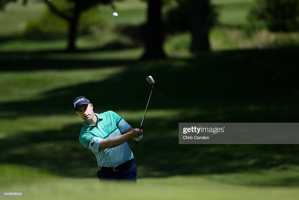 <a gi-track='captionPersonalityLinkClicked' href=/galleries/search?phrase=Russell+Knox&family=editorial&specificpeople=7657969 ng-click='$event.stopPropagation()'>Russell Knox</a> chips to the first green during the first round of the World Golf Championships-Bridgestone Invitational at Firestone Country Club on June 30, 2016 in Akron, Ohio.