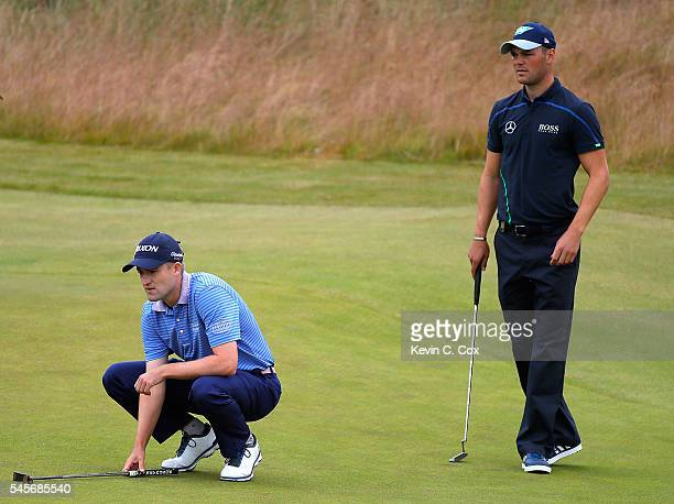 Russell Knox of Scotland and Martin Kaymer line up on the 5th hole during the third round of the AAM Scottish Open at Castle Stuart Golf Links on...