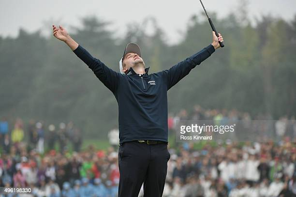 Russell Knox of Scotland celebrates winning the tournament on the 18th hole during the final round of the WGC HSBC Champions at the Sheshan...