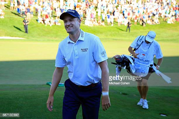 Russell Knox of Scotland comes off the 18th green after winning the Travelers Championship during the final round of the Travelers Championship at...