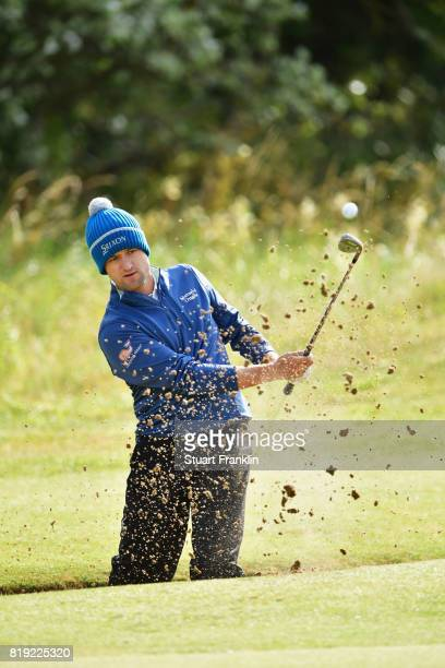 Russell Knox of Scotland hits a bunker shot on the 5th hole during the first round of the 146th Open Championship at Royal Birkdale on July 20 2017...