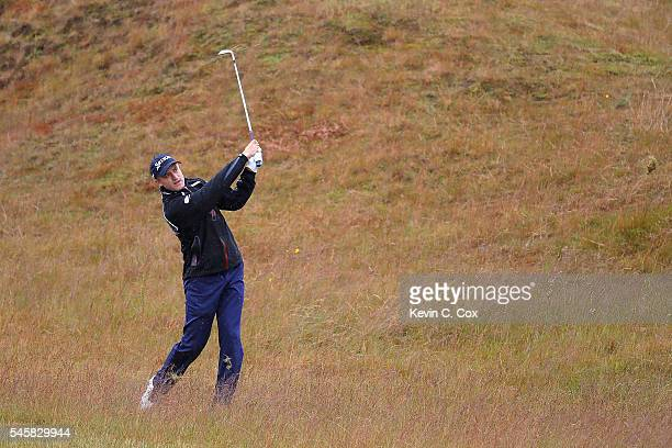Russell Knox of Scotland hits his 2nd shot on the 5th hole during the final round of the AAM Scottish Open at Castle Stuart Golf Links on July 10...