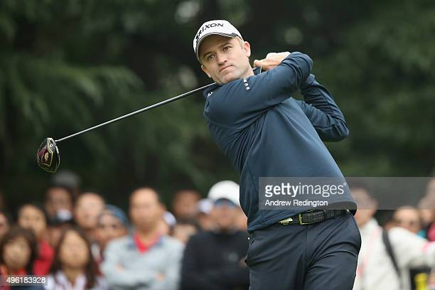 Russell Knox of Scotland hits his tee shot on the first hole during the final round of the WGC HSBC Champions at the Sheshan International Golf Club...