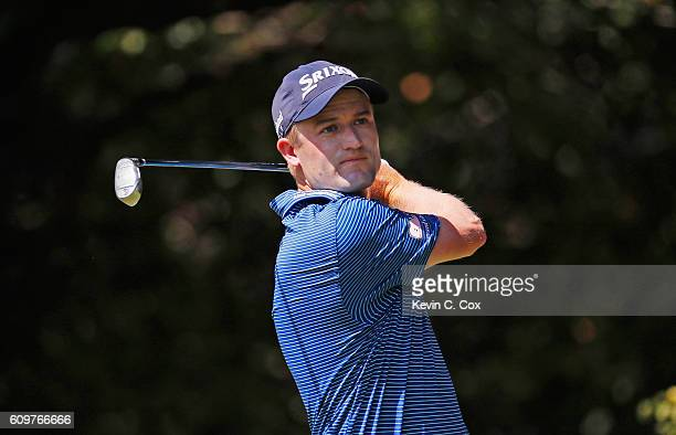 Russell Knox of Scotland hits his tee shot on the second hole during the first round of the TOUR Championship By CocaCola at East Lake Golf Club on...