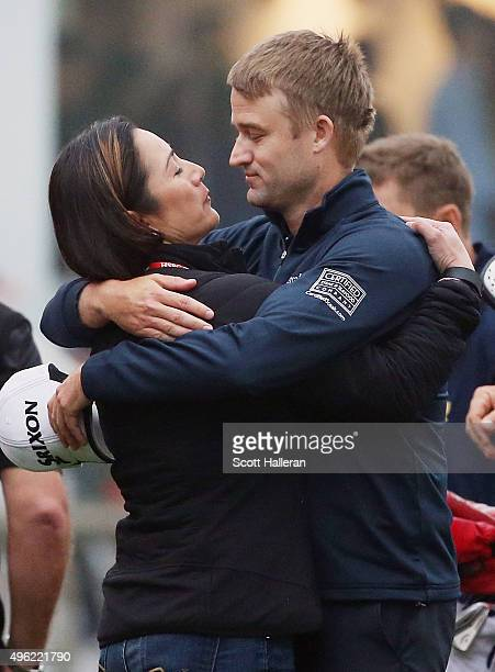 Russell Knox of Scotland hugs his wife Andrea behind the 18th green after his twostroke victory at the WGC HSBC Champions at the Sheshan...