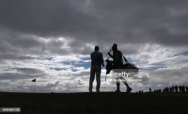 Russell Knox of Scotland is pictured with his caddie on the 13th green during the second round of the AAM Scottish Open at Castle Stuart Golf Links...