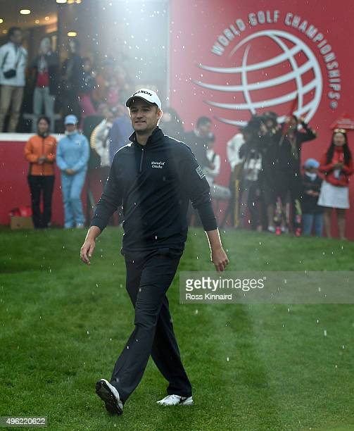 Russell Knox of Scotland makes his way to the trophy presention after the final round of the WGC HSBC Champions at the Sheshan International Golf...