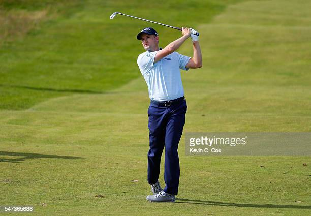 Russell Knox of Scotland plays a shot during the first round on day one of the 145th Open Championship at Royal Troon on July 14 2016 in Troon...