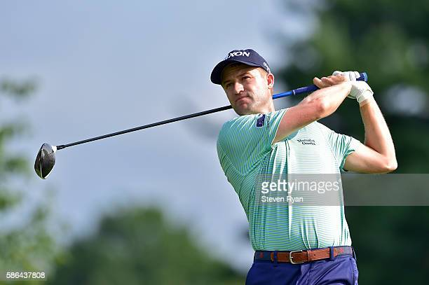 Russell Knox of Scotland plays his shot from the second tee during the third round of the Travelers Championship at TCP River Highlands on August 6...