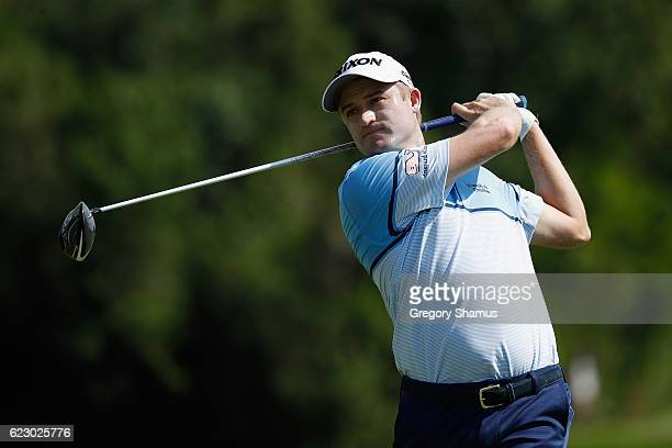 Russell Knox of Scotland plays his shot from the sixth tee during the final round of the OHL Classic at Mayakoba on November 13 2016 in Playa del...