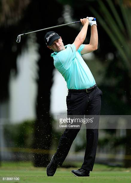Russell Knox of Scotland plays his tee shot at the par 3 13th hole during the first round of the 2016 World Golf Championship Cadillac Championship...
