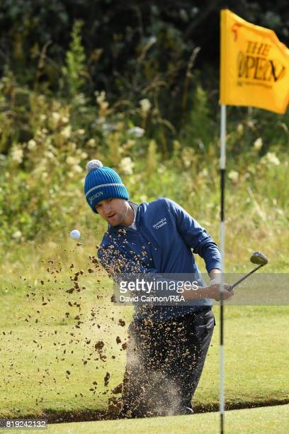 Russell Knox of Scotland plays out of a bunker on the fifth hole during the first round of the 146th Open Championship at Royal Birkdale on July 20...