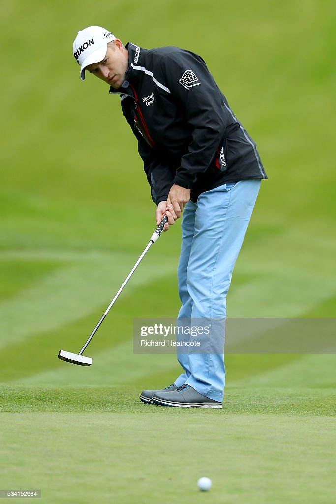 <a gi-track='captionPersonalityLinkClicked' href=/galleries/search?phrase=Russell+Knox&family=editorial&specificpeople=7657969 ng-click='$event.stopPropagation()'>Russell Knox</a> of Scotland putts during the Pro-Am prior to the BMW PGA Championship at Wentworth on May 25, 2016 in Virginia Water, England.
