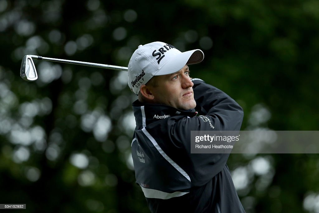 <a gi-track='captionPersonalityLinkClicked' href=/galleries/search?phrase=Russell+Knox&family=editorial&specificpeople=7657969 ng-click='$event.stopPropagation()'>Russell Knox</a> of Scotland tees off during the Pro-Am prior to the BMW PGA Championship at Wentworth on May 25, 2016 in Virginia Water, England.