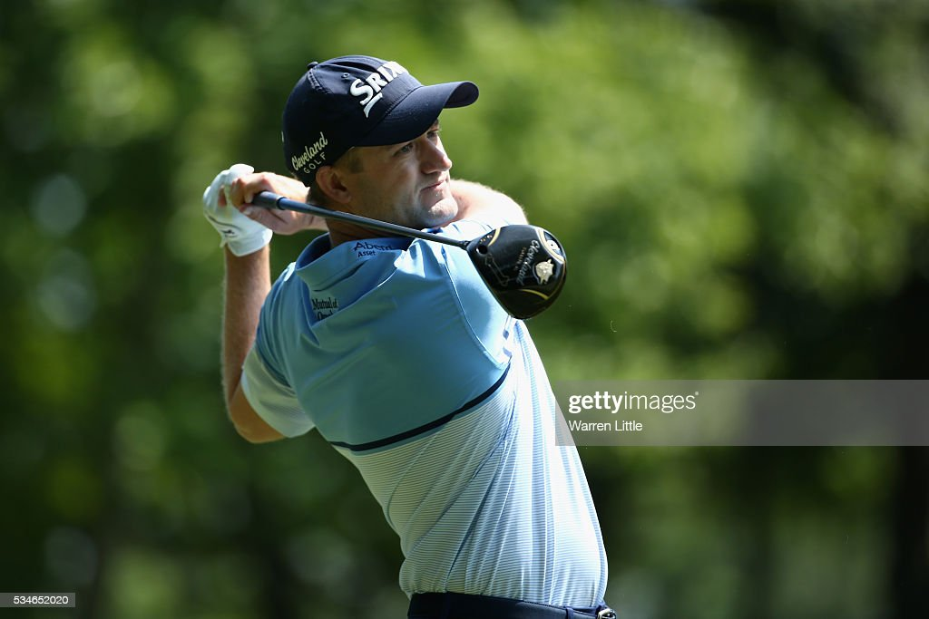 <a gi-track='captionPersonalityLinkClicked' href=/galleries/search?phrase=Russell+Knox&family=editorial&specificpeople=7657969 ng-click='$event.stopPropagation()'>Russell Knox</a> of Scotland tees off on the 3rd hole during day two of the BMW PGA Championship at Wentworth on May 27, 2016 in Virginia Water, England.
