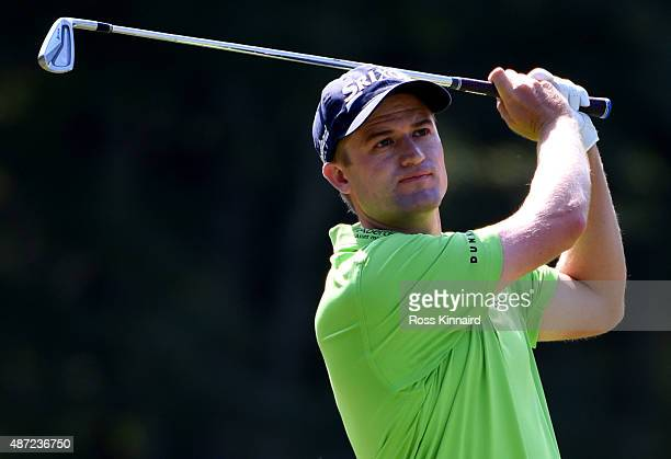 Russell Knox of Scotland watches his secon shot on the fifth hole during the final round of the Deutsche Bank Championship at TPC Boston on September...