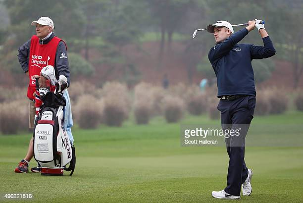 Russell Knox of Scotland watches his second shot on the 11th hole during the final round of the WGC HSBC Champions at the Sheshan International Golf...