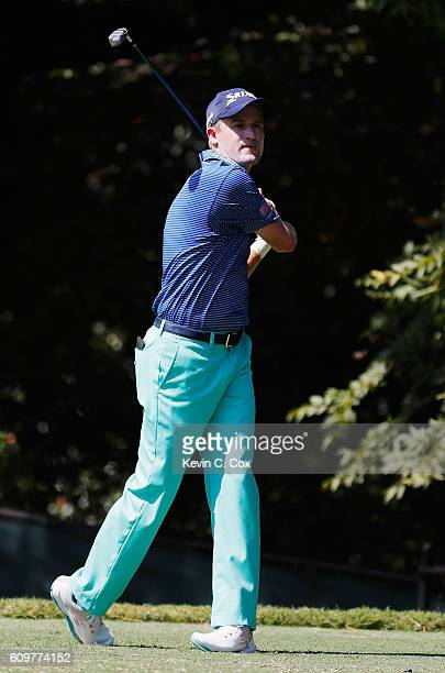 Russell Knox of Scotland watches his tee shot on the second hole during the first round of the TOUR Championship By CocaCola at East Lake Golf Club...