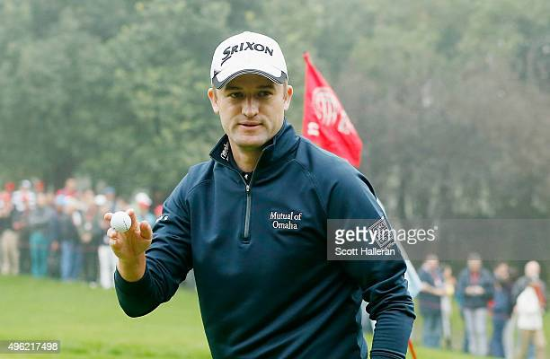 Russell Knox of Scotland waves to the gallery on the 12th hole during the final round of the WGC HSBC Champions at the Sheshan International Golf...