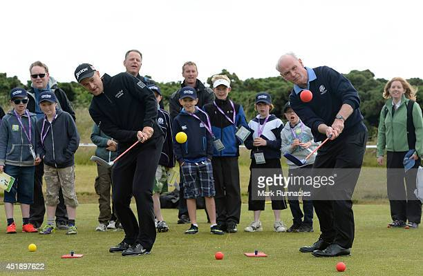 Russell Knox of Scotland with Sandy Jones chief executive of the Professional Golfers' Association during a Club Golf event at Murcar Links during...