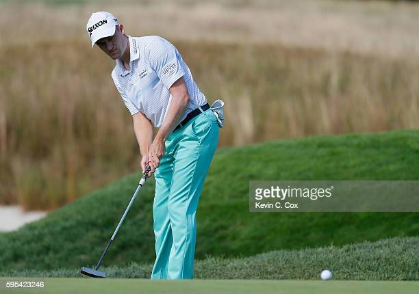 Russell Knox putts on the 11th green during the first round of The Barclays in the PGA Tour FedExCup PlayOffs on the Black Course at Bethpage State...