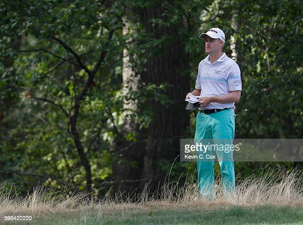 Russell Knox waits to play his second shot on the 13th hole during the first round of The Barclays in the PGA Tour FedExCup PlayOffs on the Black...