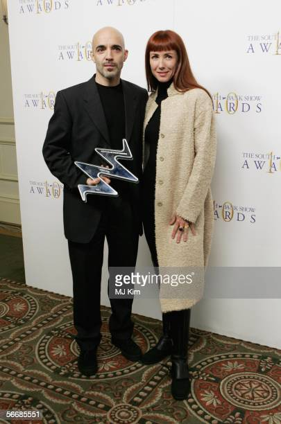 Russell Maliphant and Sylvie Guillem poses in the press room with the Dance award for PUSH at the South Bank Show Awards at The Savoy Hotel on...