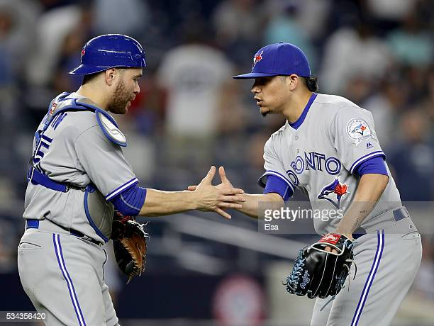 Russell Martin and Roberto Osuna of the Toronto Blue Jays celebrate the 84 win over the New York Yankees at Yankee Stadium on May 25 2016 in the...