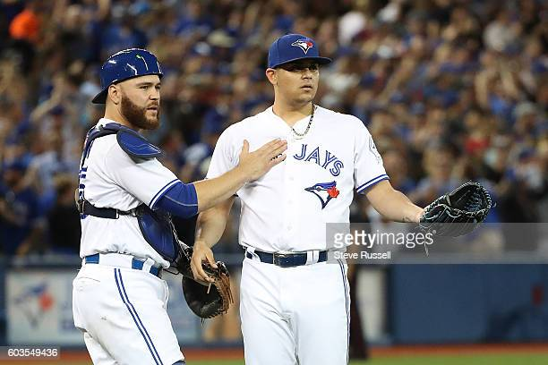 TORONTO ON SEPTEMBER 12 Russell Martin holds back Roberto Osuna as Steven Souza Jr yells over as the Toronto Blue Jays play the Tampa Bay Rays in...