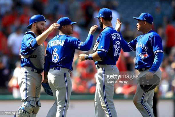 Russell Martin Jose Bautista and Ezequiel Carrera congratulate Marcus Stroman of the Toronto Blue Jays after defeating the Los Angeles Angels of...