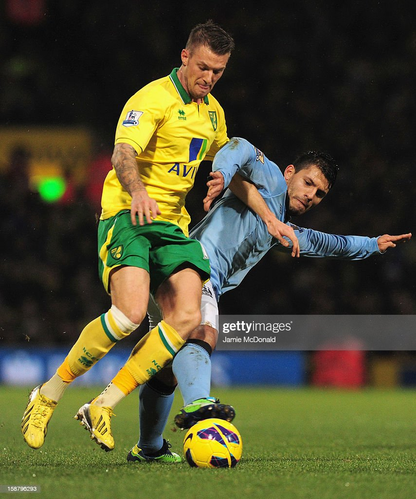 Russell Martin of Norwich City and Sergio Aguero of Manchester City battle for the ball during the Barclays Premier League match between Norwich City and Manchester City at Carrow Road on December 29, 2012 in Norwich, England.