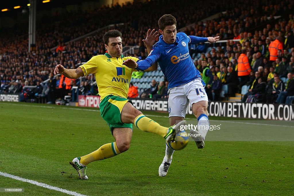 <a gi-track='captionPersonalityLinkClicked' href=/galleries/search?phrase=Russell+Martin+-+Soccer+Player&family=editorial&specificpeople=13764026 ng-click='$event.stopPropagation()'>Russell Martin</a> of Norwich City blocks the effort from Tommy Rowe of Peterborough United during the FA Cup with Budweiser third round match between Peterborough United and Norwich City at London Road Stadium on January 5, 2013 in Peterborough, England.