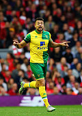 Russell Martin of Norwich City celebrates as he scores their first and equalising goal during the Barclays Premier League match between Liverpool and...