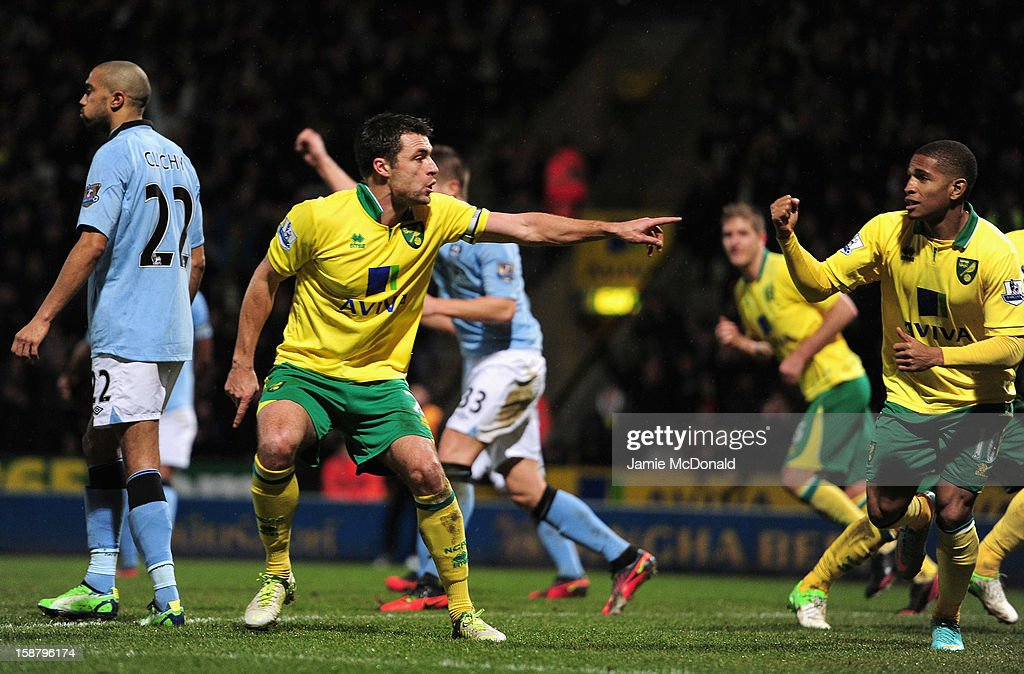 Russell Martin of Norwich City celebrates scoring his second goal and his side's third during the Barclays Premier League match between Norwich City and Manchester City at Carrow Road on December 29, 2012 in Norwich, England.
