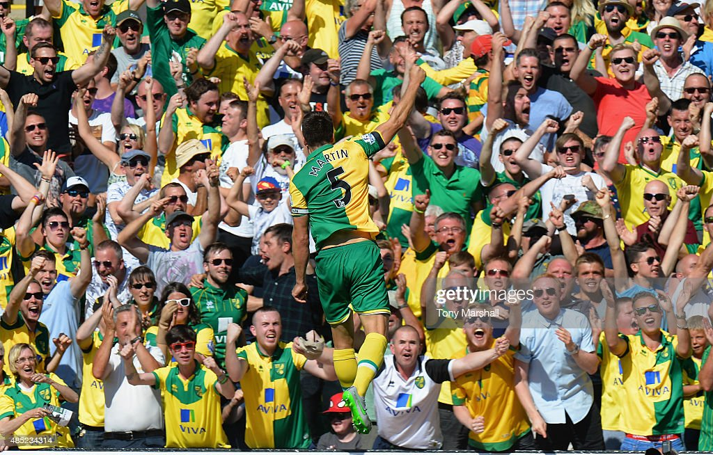Russell Martin of Norwich City celebrates scoring in front of the Norwich City fans during the Barclays Premier League match between Norwich City and...