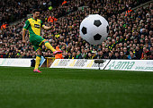 Russell Martin of Norwich City clears a giant football from the pitch during the Premier League match between Norwich and Tottenham Hotspur at Carrow...