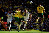 Russell Martin of Norwich City scores his goal during the Barclays Premier League match between Norwich City and Swansea City at Carrow Road on...