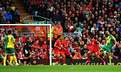 Russell Martin of Norwich City scores their first and equalising goal during the Barclays Premier League match between Liverpool and Norwich City at...