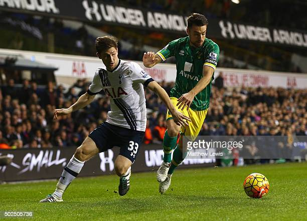 Russell Martin of Norwich City takes on Ben Davies of Tottenham Hotspur during the Barclays Premier League match between Tottenham Hotspur and...