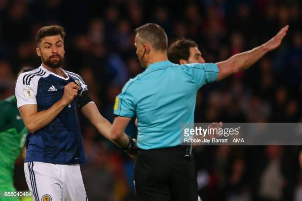Russell Martin of Scotland reacts after having a goal disallowed during the FIFA 2018 World Cup Qualifier between Scotland and Slovenia at Hampden...
