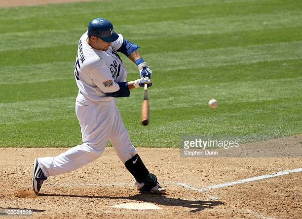 Russell Martin of the Los Angeles Dodgers hits an RBI double which accounts for the game's only run in the eighth nning against the New York Mets on...