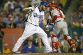 Russell Martin of the Los Angeles Dodgers reacts after striking out in the sixth inning as catcher Carlos Ruiz of the Philadelphia Phillies runs off...