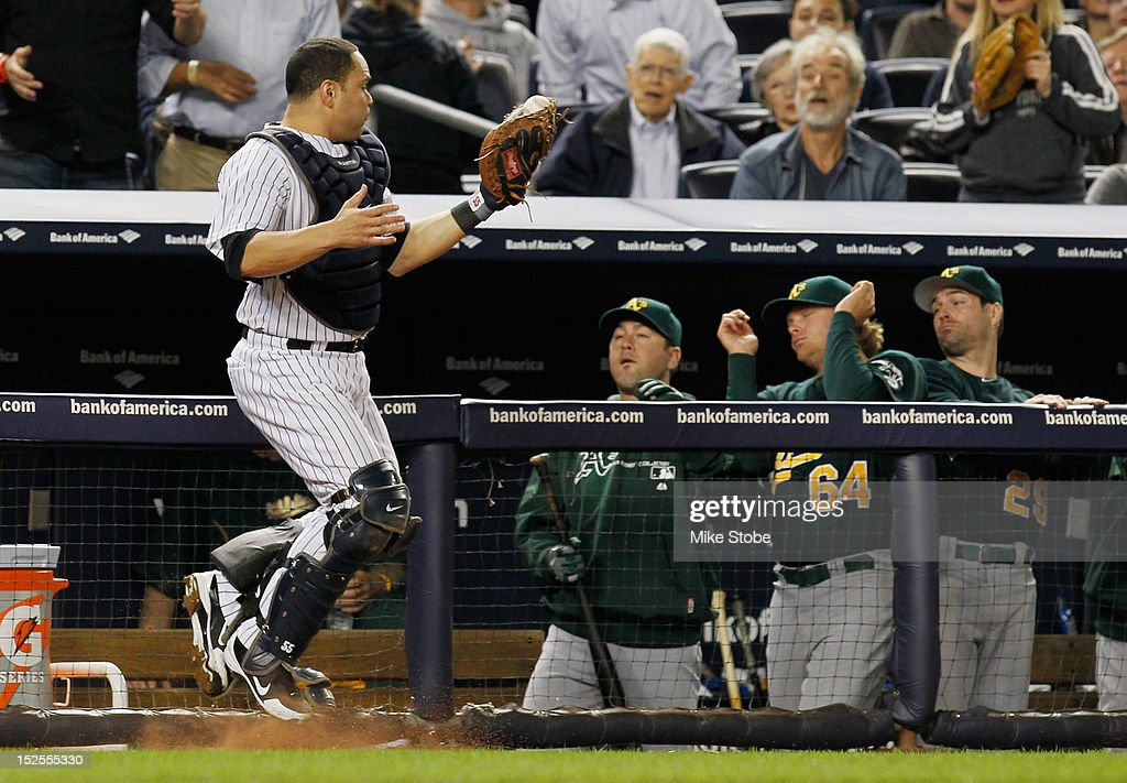 Russell Martin #55 of the New York Yankees catches a pop fly against the Oakland Athletics at Yankee Stadium on September 21, 2012 in the Bronx borough of New York City. The Yankees defeated the Athletics 2-1 in 10 innings.